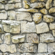 Wall of stone in winter — Stock Photo