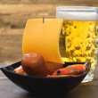 Beer, sausages, shrimp - appetizer Sailboat - Stock Photo