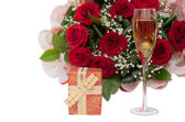 Champagne, gift, roses — Stock Photo