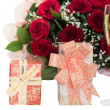 Stock Photo: Roses, champagne, boxes of gifts