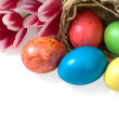 Royalty-Free Stock Photo: Easter eggs and tulips with straw baskets