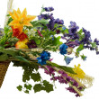 Spring flowers in a basket - Stock Photo
