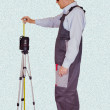 Stock Photo: Foremchecks quality of laser level
