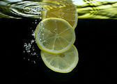 Lemon in liquid — Stock Photo