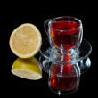 Stock Photo: Red teand lemon with reflection
