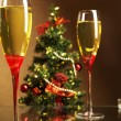 Stock Photo: Champagne, Christmas tree and candle