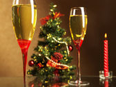 Champagne, Christmas tree and candle — Stock Photo
