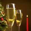 Stock Photo: Christmas tree, Champagne, and candle