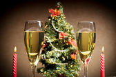 Christmas tree, champagne and candles — Stock Photo