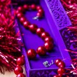 Red beads in lilac box — Stock Photo #15719789