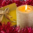 Royalty-Free Stock Photo: Gold candle with gift