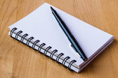 Notebook with pen — Stock Photo