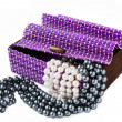 Violet casket with pearls — Stock Photo