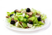 Fresh salad with lettuce, meat and olives — Stock Photo