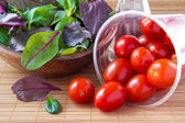 Spilled cherry tomatoes and salad — Stock Photo