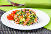 Salad with avocado and red fish — Stock Photo