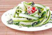 Salad from the zucchini ribbons, tomato and black olive — Stock Photo