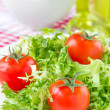 Frizzy crisp lettuce with cherry tomatoes — Stock Photo