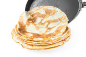 Pancakes from the frying pan on plate — Stok fotoğraf
