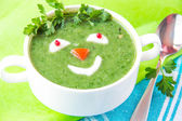 Funny healthy soup with spinach for children — Stock Photo