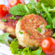 Chicken cutlets with salad greens - Stock Photo