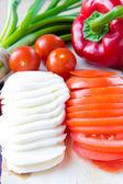 Fresh Italian ingredients - sliced mozzarella and tomatoes — Stock Photo
