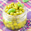 Tinned green peas in glass jar — Stockfoto