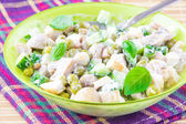 Salad with green peas, chicken, mushrooms, cucumber and mayonnai — Stock Photo