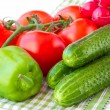 Young vegetables of a new crop: a branch of tomatoes, cucumbers, — Stock Photo