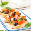 Classic Italiappetizer bruschettwith tomato, basil and blac — Stock Photo #26942247