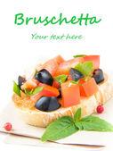 Classic Italian appetizer bruschetta with tomato, basil and blac — Stock Photo