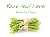 A bunch of fresh leguminous green beans on white background — Stock Photo