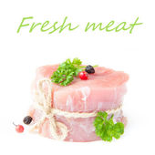 Fresh fillet of raw meat with spices and herbs on a white backgr — Stock Photo