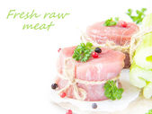 Two isolated fresh fillet of raw meat with spices and herbs on a — Stock Photo