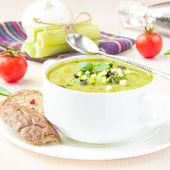 Vegetable green healthy cream soup with avocado, celery, zucchin — Stock Photo