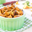 Fried summer golden chanterelle mushrooms with herbs in green cu — Stock Photo