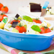 Mixed vegetable in blue bowl for baked in oven — Stock Photo #27435997