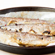 Tasty dish is baked in a pan rainbow trout with onions and spice — Stock Photo