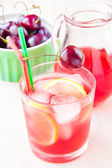 Delicious sweet berry juice of cherry in glass and carafe — Stock Photo