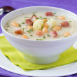 Cream soup with cauliflower, white beans and fried bacon in whit — Stock Photo #33948745