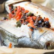 Baked whole white fish, sea bass stuffed with black olives, cape — Stock Photo