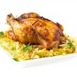 Roasted whole chicken with golden crust and garnish of stewed ca — Stock Photo #33949157