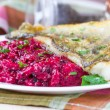 Fried fish fillet of perch with mashed beet and potato — Stock Photo #33949671