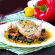 Ragout from stewed legs of rabbit with herbs, vegetables and oli — Stock Photo