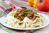 Italian pasta tagliatelle with meat sauce and vegetables, tasty — Stock Photo