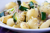 Pasta with tuna, zucchini, sauce and herbs on plate, delicious d — Stock Photo
