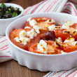 Stock Photo: Tomatoes baked with cheese feta, smoked sausages, herbs, olives,