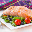 Fillet of red fish salmon with green beans, tomatoes and black o — Stock Photo #39682991