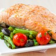 Fillet of red fish salmon with green beans, tomatoes and black o — Stock Photo #39682993