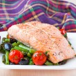 Fillet of red fish salmon with green beans, tomatoes and black o — Stock Photo #39682995